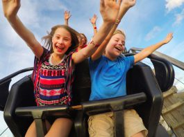 children ride rollercoaster at fun spot america