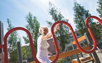 lady in play park senior play