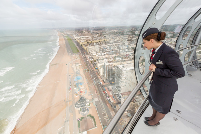 UK attractions air hostess looking at view British Airways i360