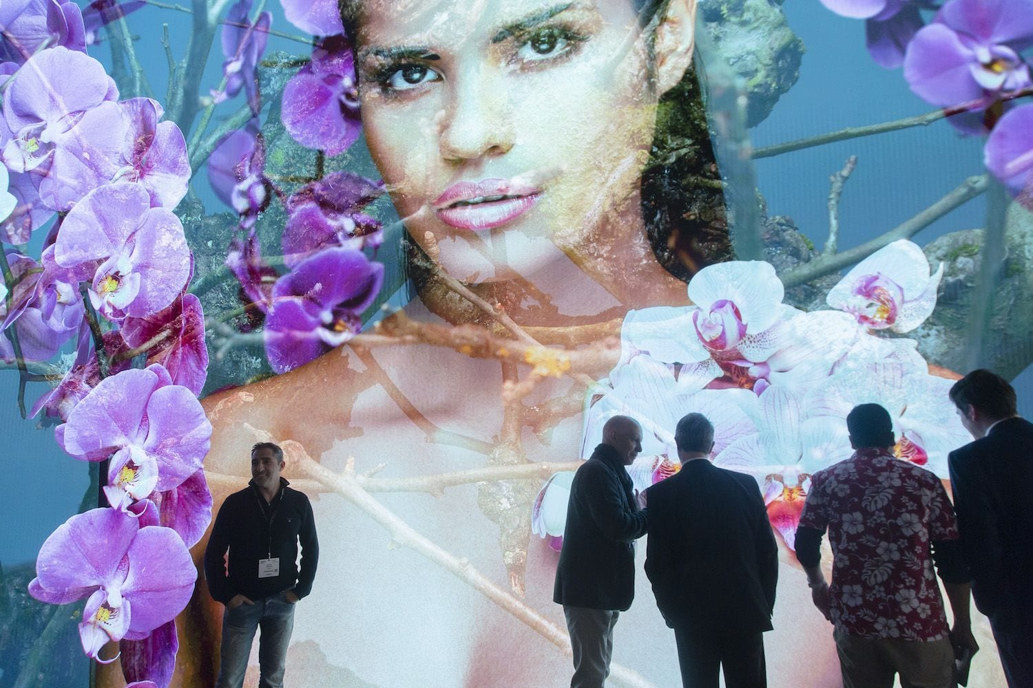 womens face on large screen audiovisual display at ise