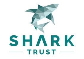 The Shark Trust Logo