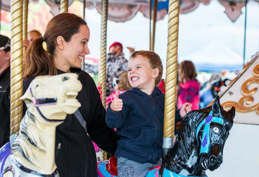 mother and child on carousel theme park investment adbobe copy 1 (1)