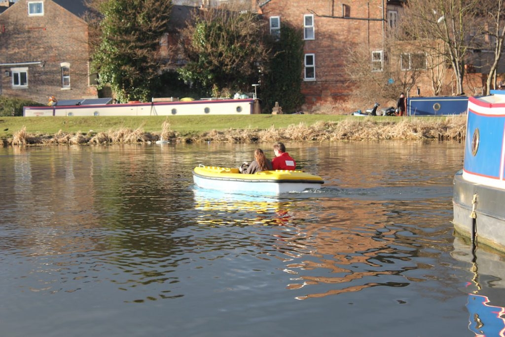 Two passengers enjoying the electric boats by Garmendale on open water