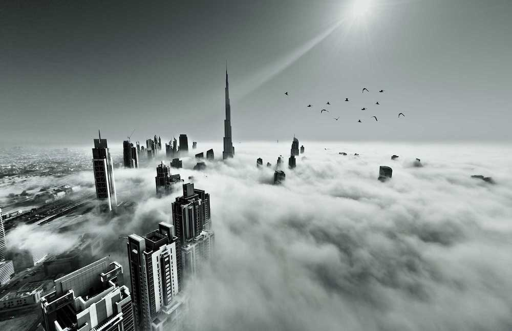 dubai skyscrapers through the clouds