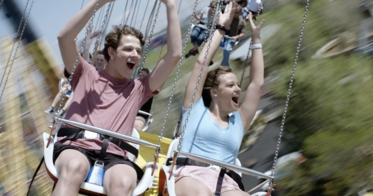 mand and woman on star flyer ride entertainment funtime attraction