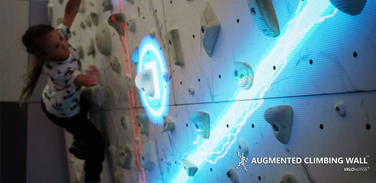 Augmented Climbing Wall by Valo Motion: Try out the world's first gaming platform for indoor climbing walls at IAAPA Expo