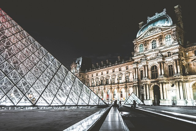 External view of the Louvre Museum, Paris at night.
