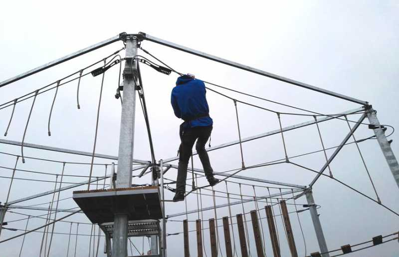 climber tests skills on kanopeo's SUMAA mobile aerial adventure trailer