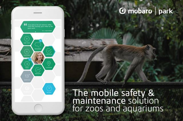 monkey in background mobile phone showing mobaro park safety solution for zoos