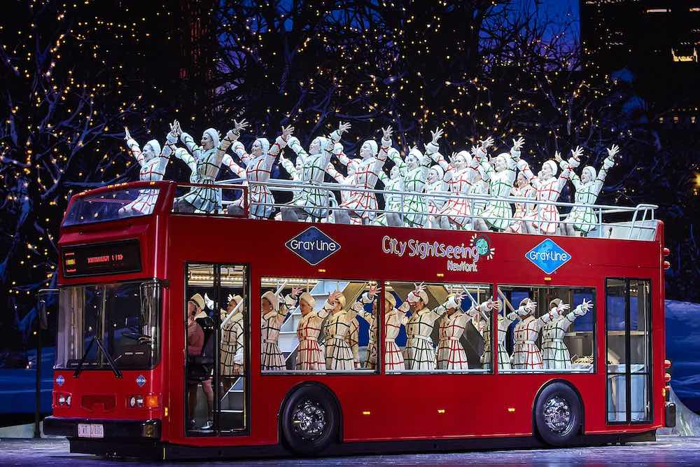 radio city rockettes on a red bus madison square garden