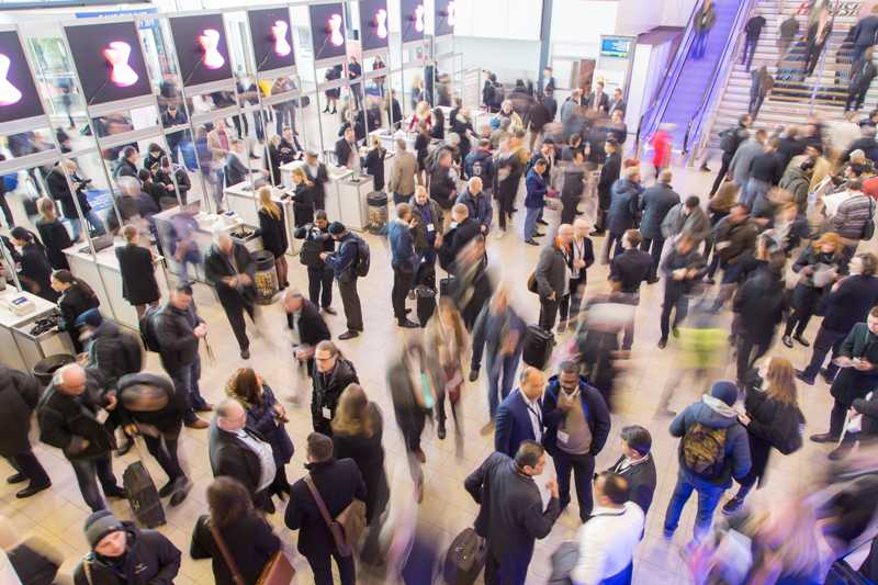 crowds of people at integrated systems europe AV trade show