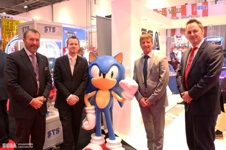 staff from sega and superbowl uk next to sonic the hedgehog