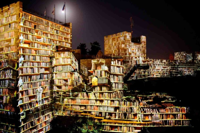 digital projection on tower of david museum jersusalem showing a library