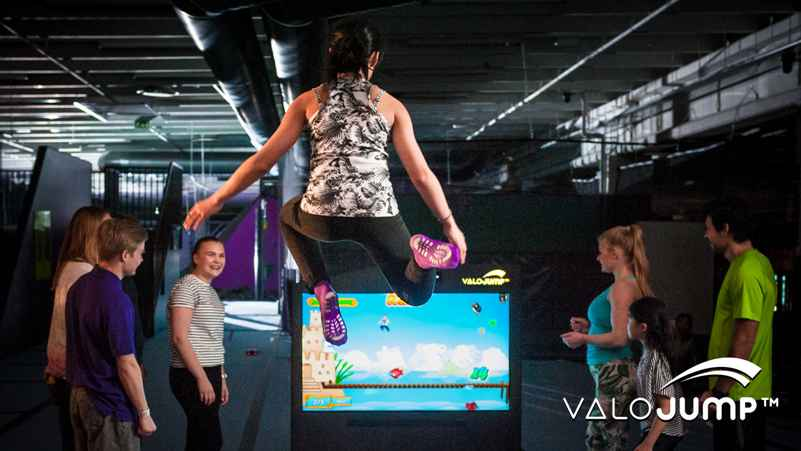 girl jumps in front of valojump screen