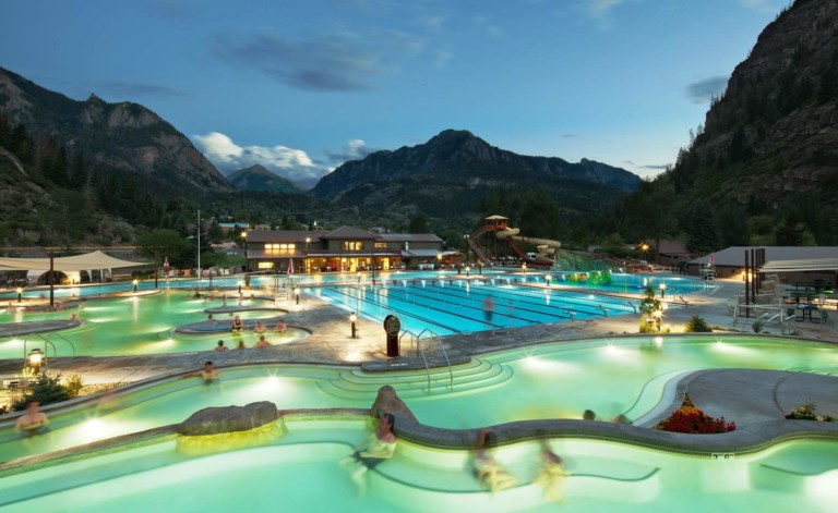 guests in ouray hot springs pool in the evening