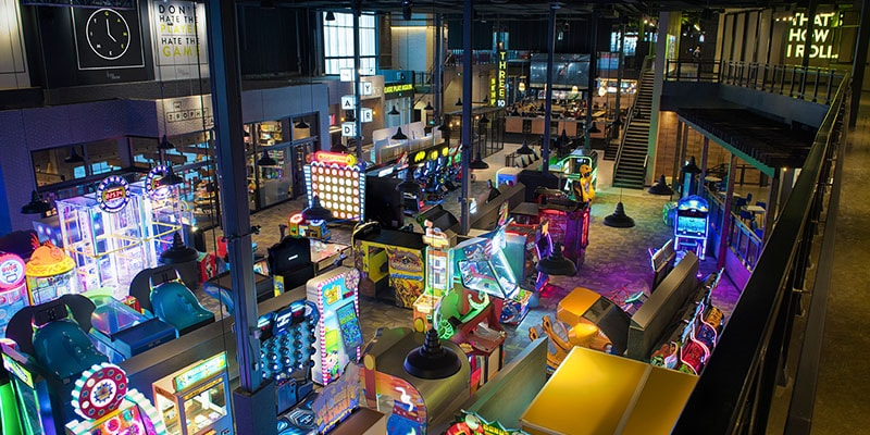 The Yard featuring amusement games at the Rec Room