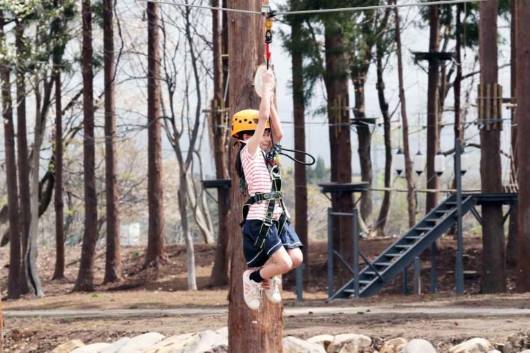 girl on aerial line at lotte arai resort japan