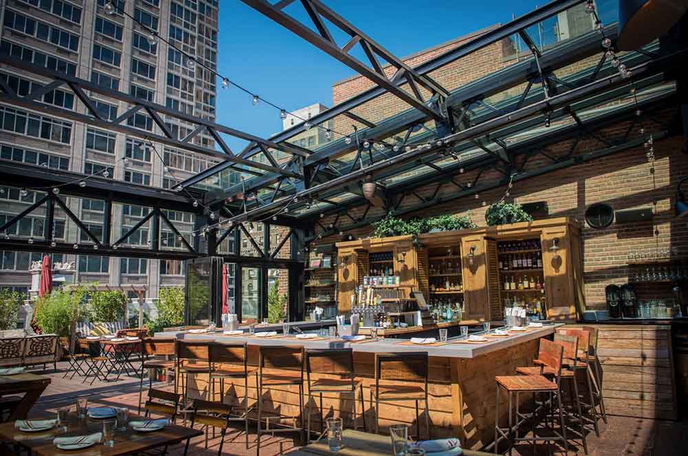 OpenAire award winning designer of retractable roof for Refinery Rooftop Bar
