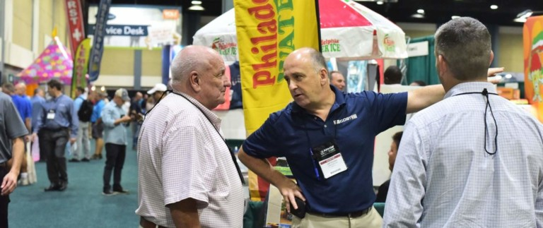attendees chatting at world waterpark association trade show las vegas