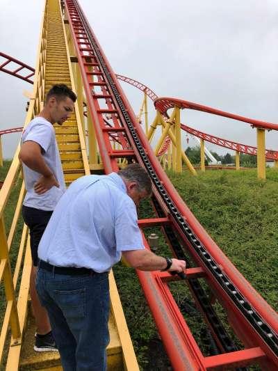 schwaben park germany - two men performing mobaro safety checks on coaster