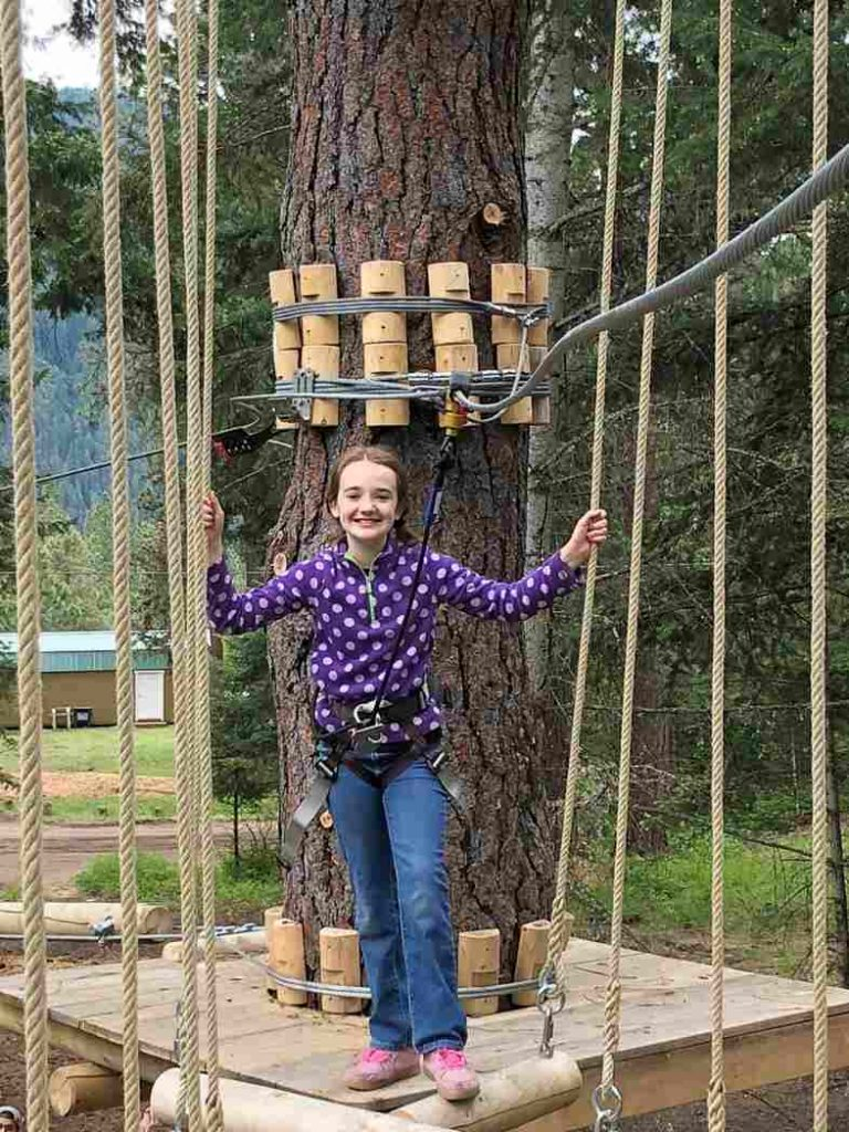 girl at tree to tree idaho in farragut state park