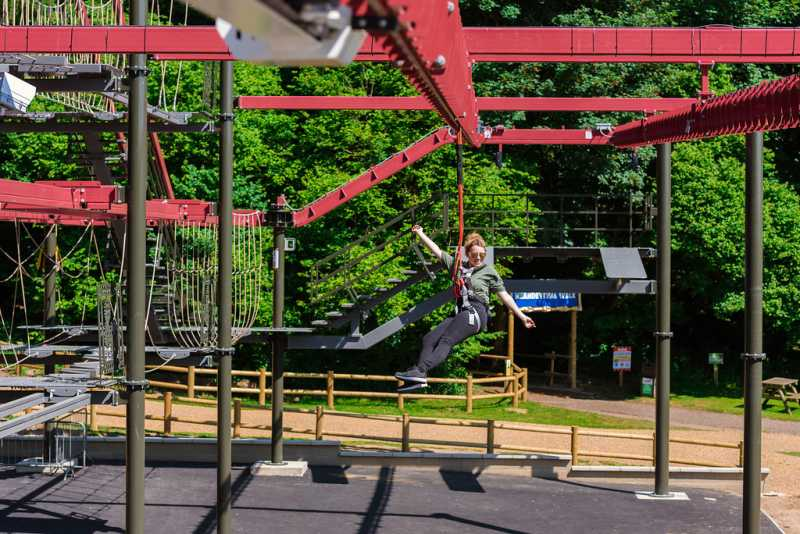 woman on predator high ropes course at roarr! dinosaur attraction