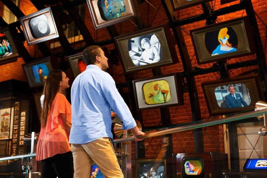 Couple watching Disney animation videos at the Walt Disney Family Museum