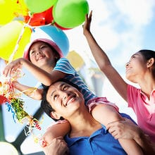 accesso, family of three enjoying themselves with balloons