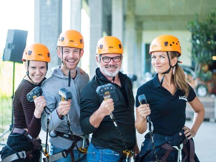 four climbers hold saferoller hardware at aspen-antwerpen