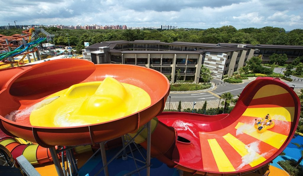 Hyrbid ride combining the Behemoth Bowl and TornadoWave. Two tier rd and yellow water slide