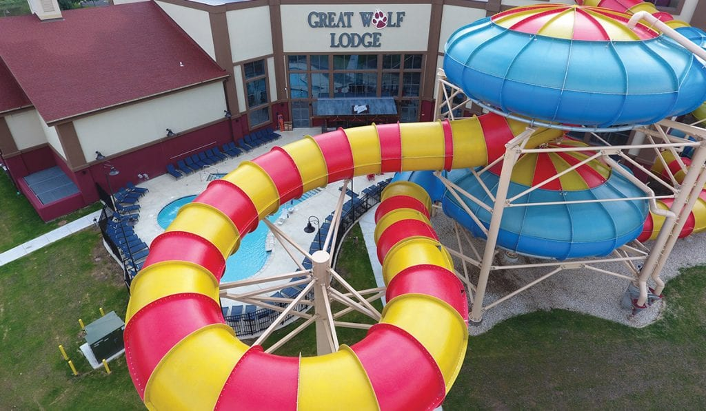 landscape image of the outside of a great wolf lodge and the behemoth bowl 40