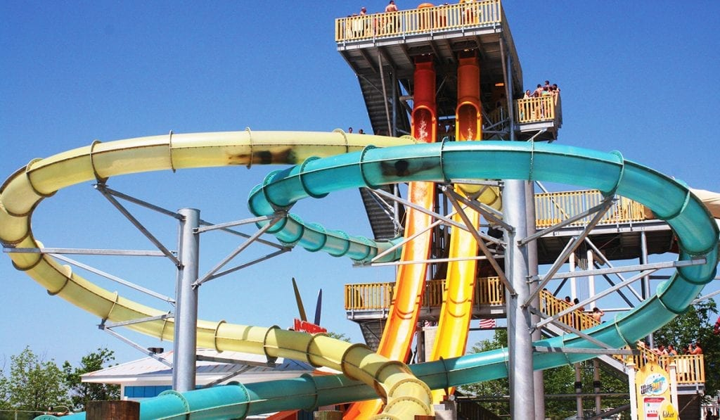 Close up view of two individuals in separate looping water slides