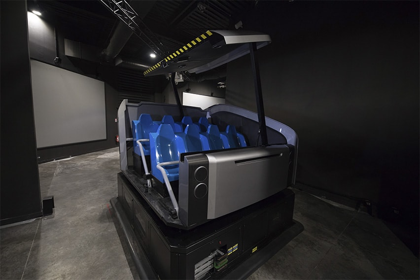 Simworx's AGV Dark Ride with door open and blue seats
