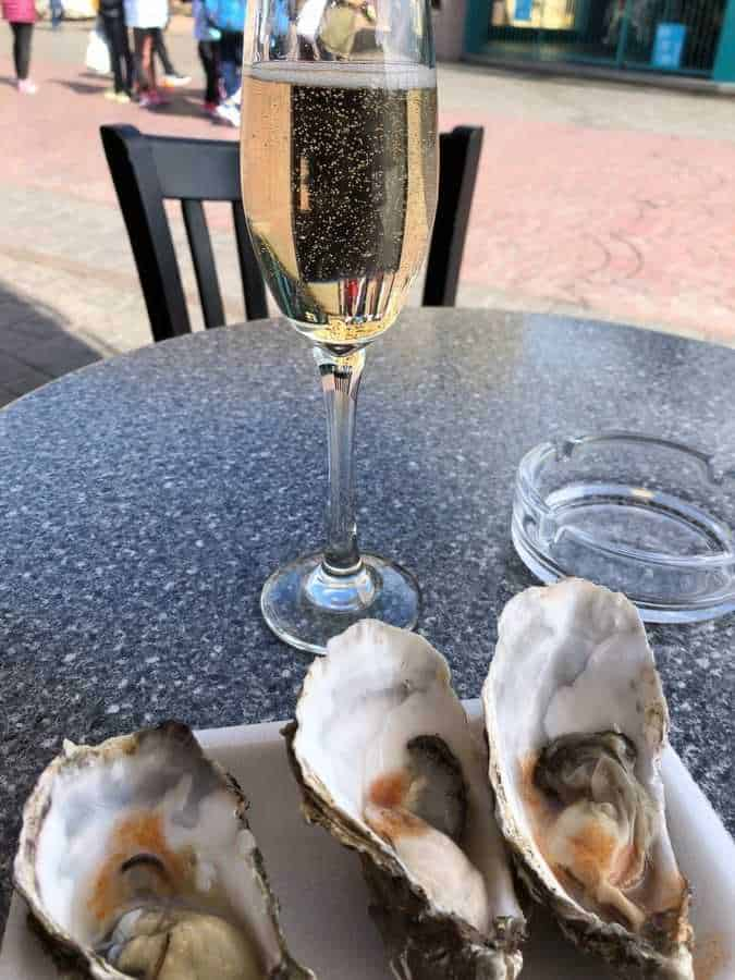 Three oysters and a glass of champagne