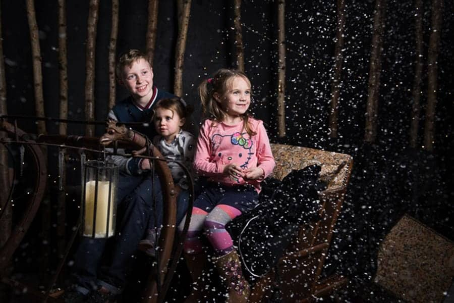 Three children on a carriage in Narnia at The Story Museum