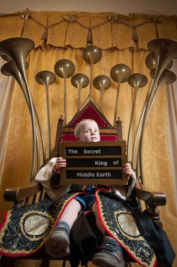 Child sitting on The Talking Throne at The Story Museum