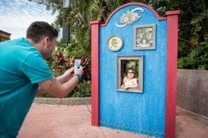 Father takes picture of his daughter posing as Frida Kahlo at Epcot's International Festival of the Arts