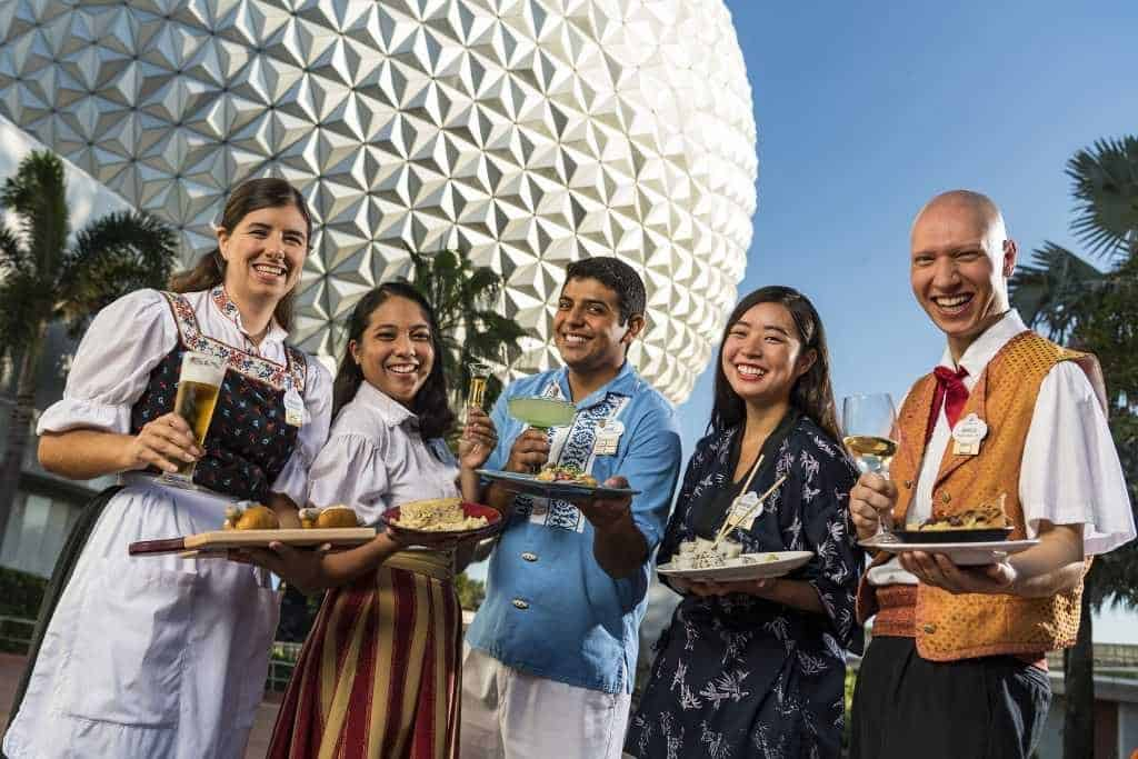 Five different cast members represent different country's food at Epcot International Food and Wine Festival