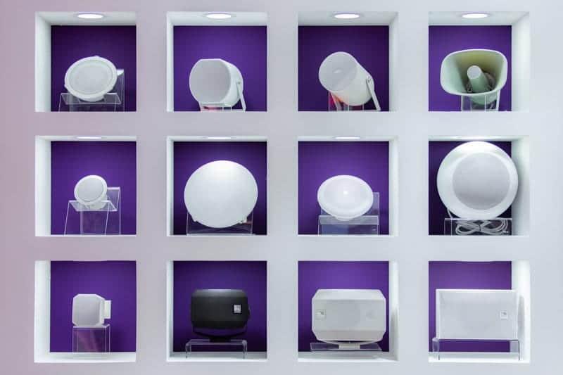 ISE 2019 speakers in shelves arranged like an art exhibit