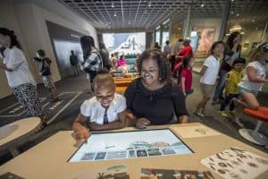 Mother and daughter interacting with education panel at the Cleveland Museum of Art