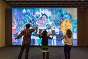 Three visitors interacting with the ArtLens Gallery at The Cleveland Museum of Art