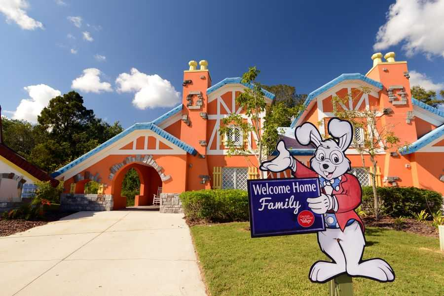 A house at Give Kids The World with Welcome Home sign outside
