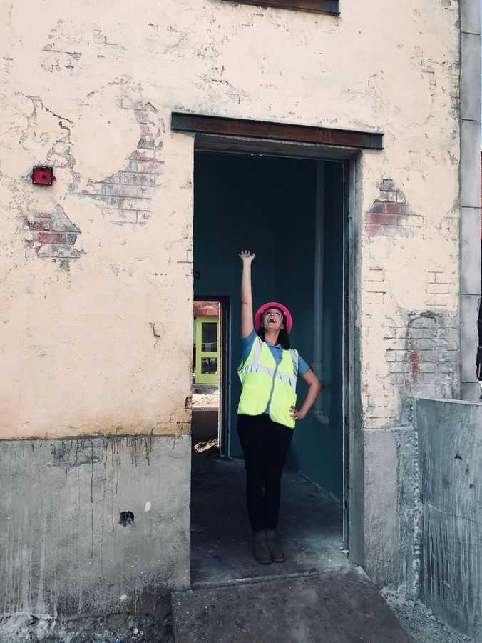 Amanda Trauger standing in a tall doorway at Sesame Street Land at SeaWorld Orlando