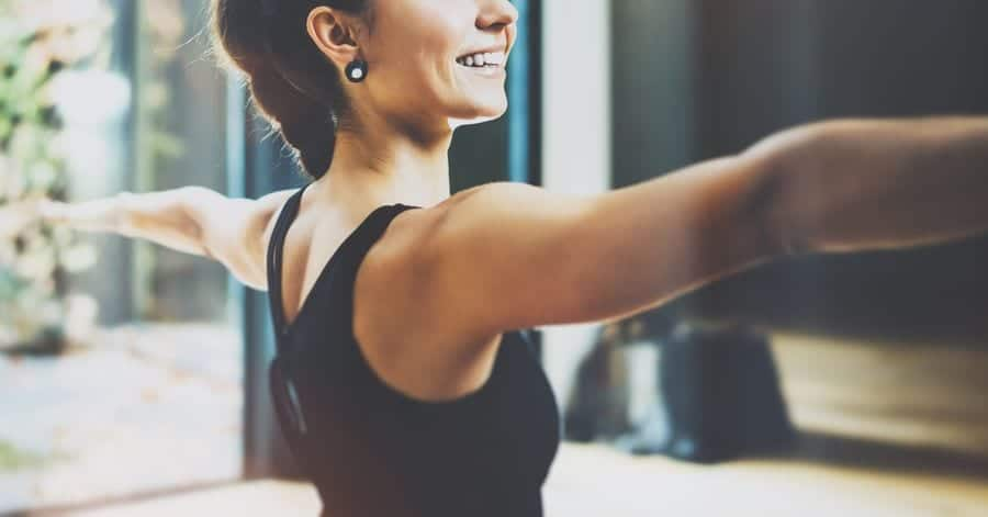 Woman exercising with her arms extended to her sides 10 travel trends