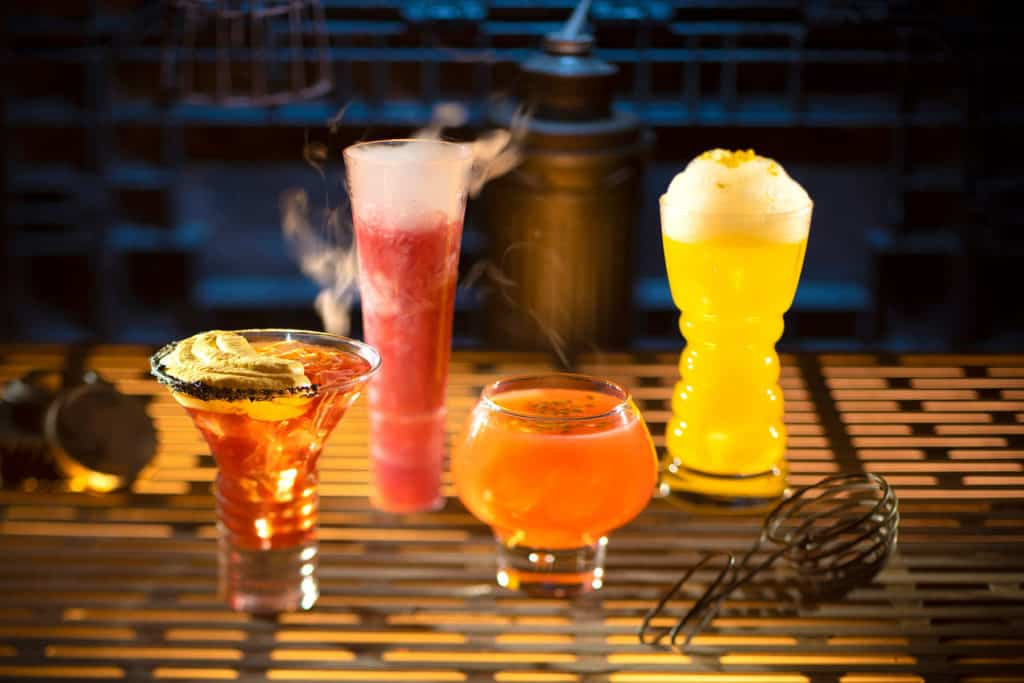From left to right, alcoholic beverages: The Outer Rim, Bespin Fizz, Yub Nub, and Fuzzy Tauntaun can be found at Oga's Cantina.