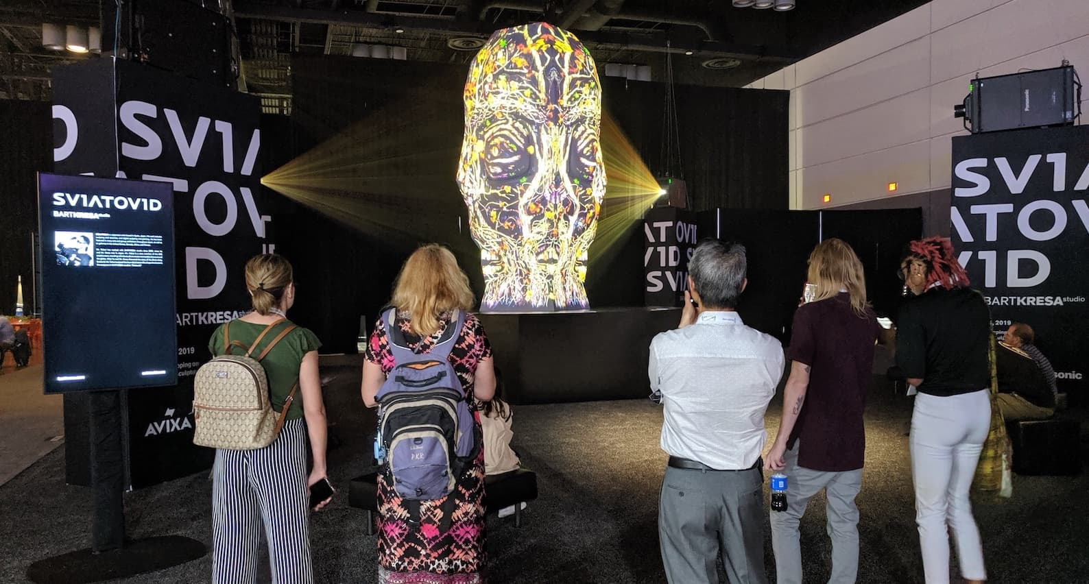 visitors watch Bart Kresa's Sviatovid projection mapping sculpture at infocomm 2019 copy