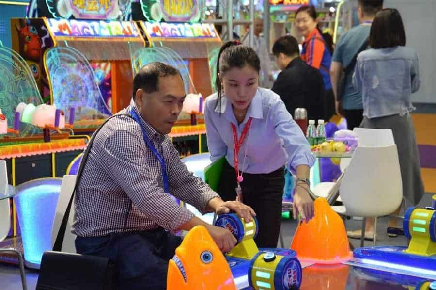 Games and Amusement Fair 2018 Vendor explains game to attendee