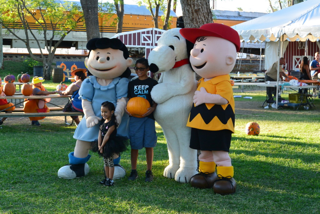 young fans pose with Peanuts characters