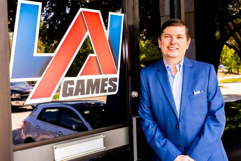 John Bugh standing in front of LAI Games sign