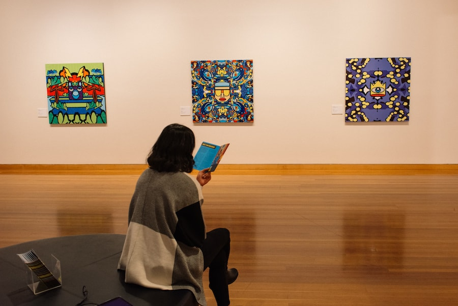 visitor reading exhibition notes for Josh Muir's WHAT'S ON YOUR MIND at Bendigo Art Gallery